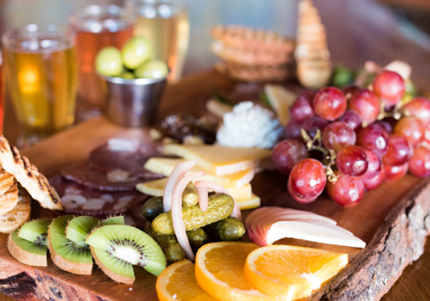 A food platter of charcuterie and Cider at Urban Orchard Cider in Asheville North Carolina